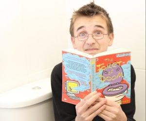 Boy reading Toilet of Doom, on the loo!