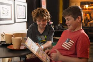 Boyshaving fun reading an annual showing that Readathon is inclusive and accessible