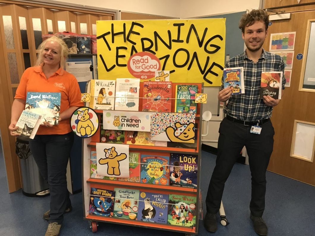 Storyteller Amanda and Specialist Learning Mentor Harry and the Read for Good bookcase