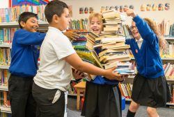 Pupils with piles of books